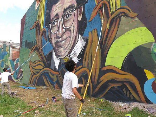 Members of MAL working on one of the artist collective's best-known murals