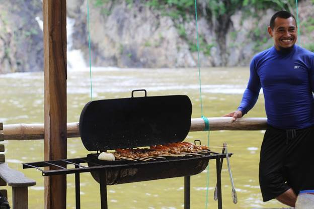 A man bbarbecuing meat