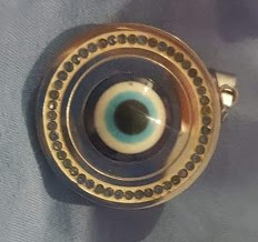 Pendants with the evil eye