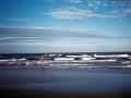 A man runs along an Argentina beach