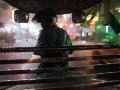 Night falls as a motorcycle rickshaw drives through the rain in Phnom Penh.
