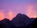 Sun sets over Cochamo peak, Chile.