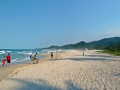 Families walk along Tayrona beach in Colombia.
