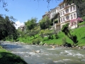 The river runs past colonial houses in Cuenca, Ecuador.