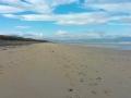 Blue skies on a beach in Ireland.