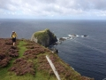 Cyclists enjoy the view from the rugged Irish coast.