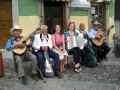 A street band takes a rest on a park bench, Mexico.