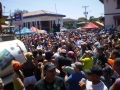 Revelers being sprayed by a water truck during carnival in Las Tablas, Panama.