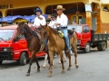 Cowboys ride through the streets of Las Tablas, Panama.