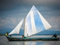A local family sail a traditional boat around the San Blas Islands, Panama.