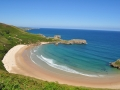 The golden sand of Torimbia beach in Spain.