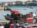 Fishing boats come into port in Spain.