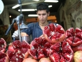 A boy makes pomegranate juice at a Turkish market.