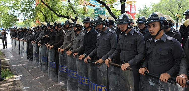 riot police in uniform lined up side by side in thailand