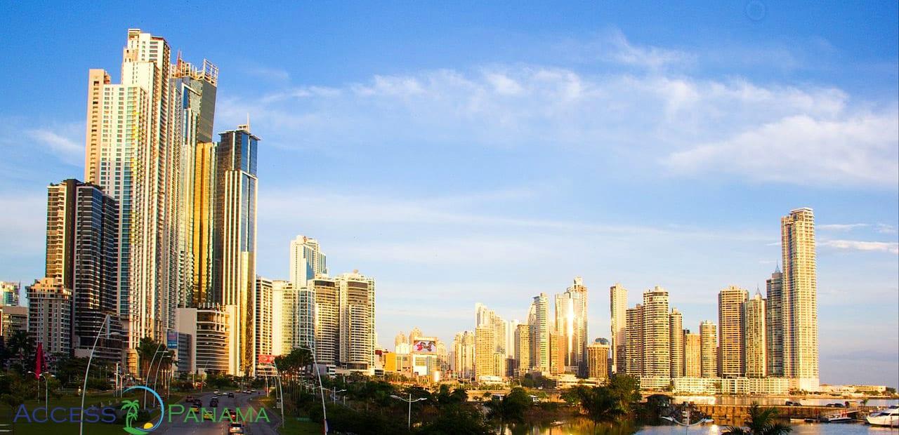 the sun shining on the tall buildings of panamas skyline