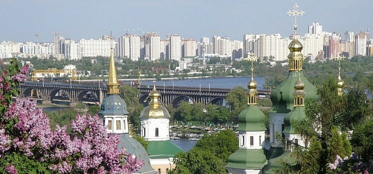 A view of Kiev, Ukraine is the distance with church steeples and a lilac tree