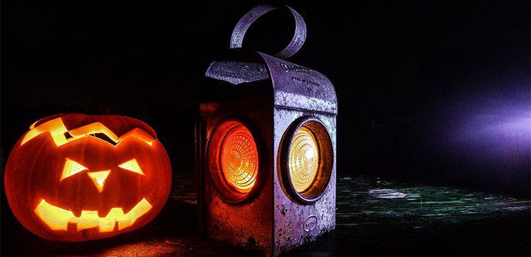 a jackolantern next to a lantern