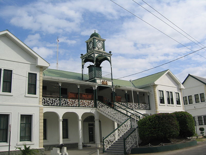 white and green building which houses the Belize supreme court
