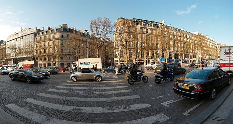 cars driving on champs elysees in Paris