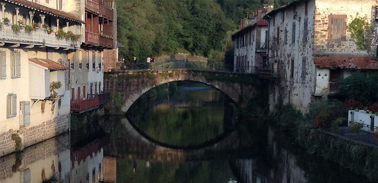 Beautiful sceneries like this river divided town come in spades when you Retire To Pays Basque France
