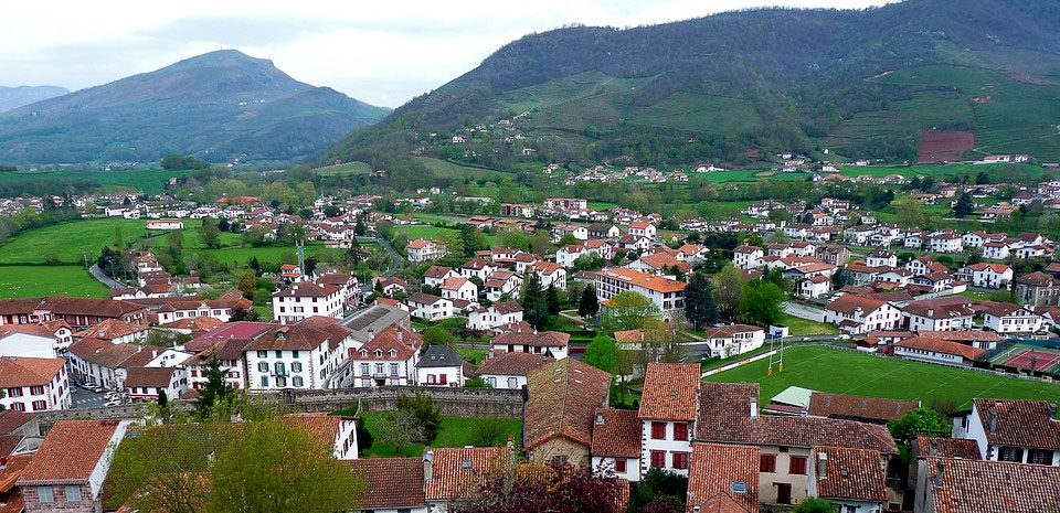 Many white and red houses dot the Basque countryside