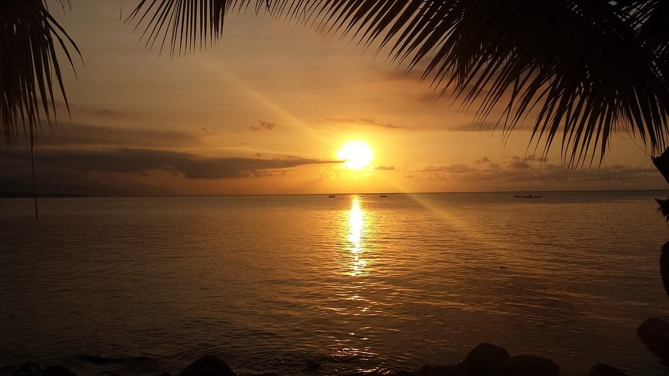 expat living in roatan honduras retire roatan sunset over the sea expat retirement life on roatan honduras