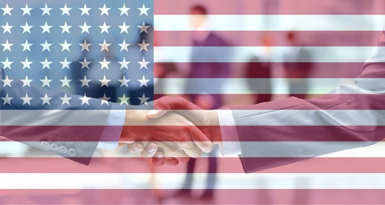 Doing business overseas and shaking hands with an american flag overlay