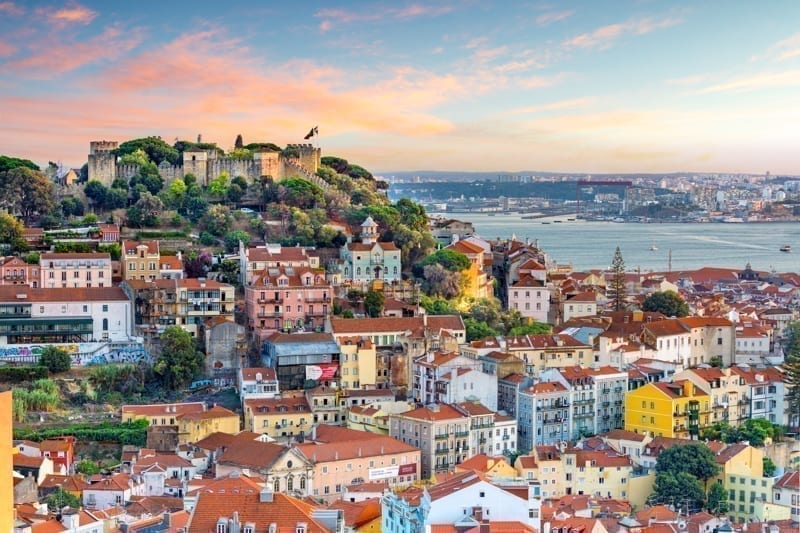 Lisbon, Portugal skyline at Sao Jorge Castle at sunset.