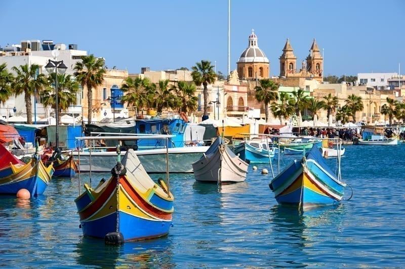 Marxaslokk harbor with traditional maltese eyed boats, Malta