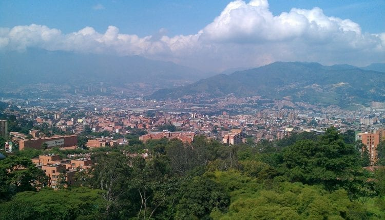 overview of rooftops and mountains in Medellin Colombia