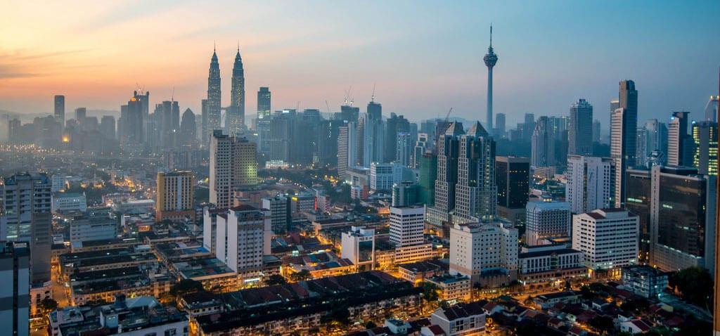 the skyline of Kuala Lumpur Malaysia at dusk