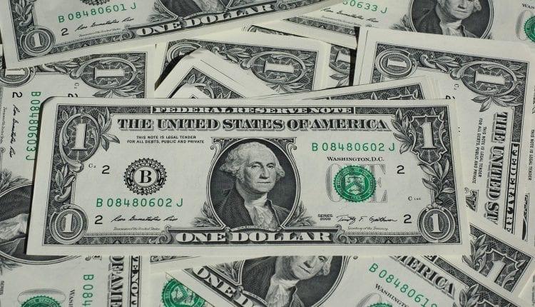 a messy pile of dollar bills