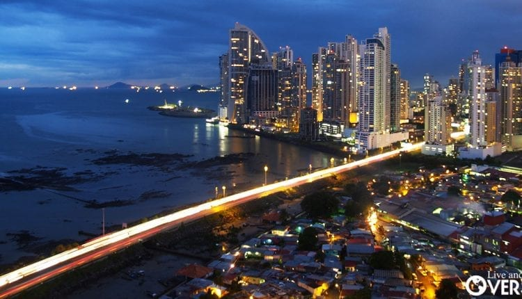 A nighttime view of the brightly lit businesses in Panama City, Panama