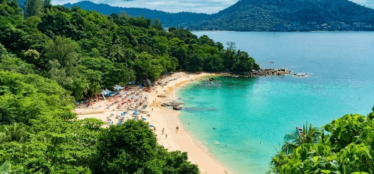 aerial view of people enjoying an isolated beach in thailand