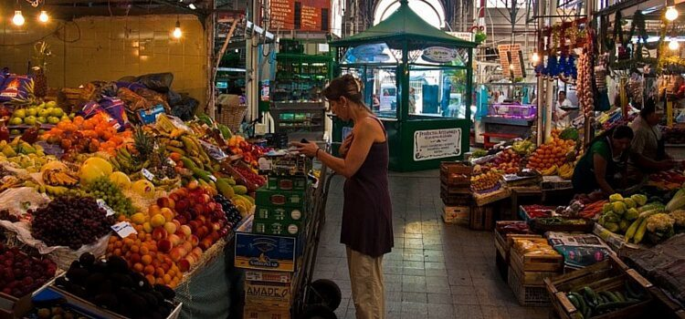 A woman shopping at the market in Argentina.