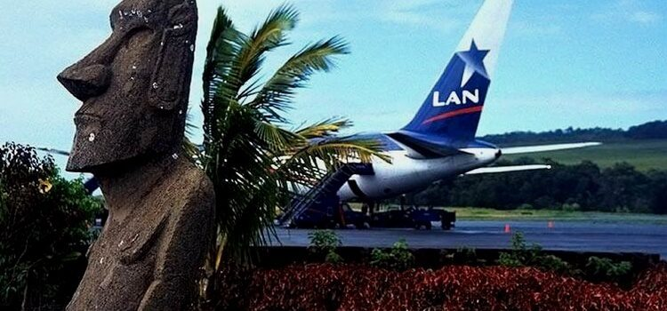 an airplane behind an easter island statue