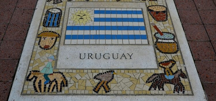 A plaque of pastimes from Uruguay, including the local people, birds, drums, and the country's flag.