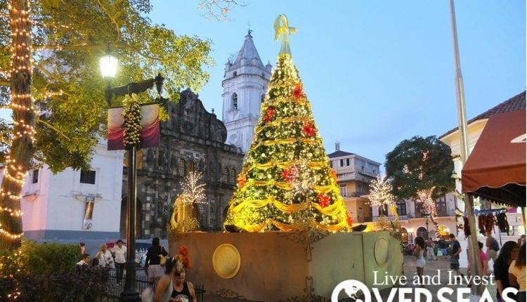 Christmas season in Panama City, Panama complete with a big Christmas tree full of yellow and red lights.