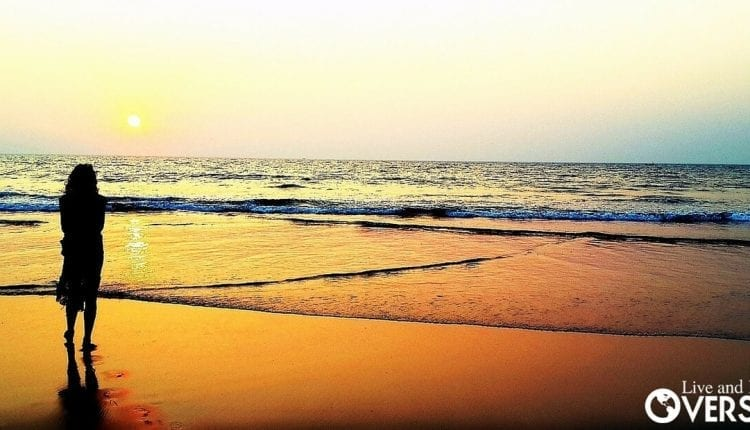 retired woman standing on beach searching for purpose. - The Real Reason To Retire Overseas Is Purpose