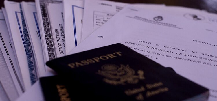 Passports and paperwork for getting a visa and residency in Argentina