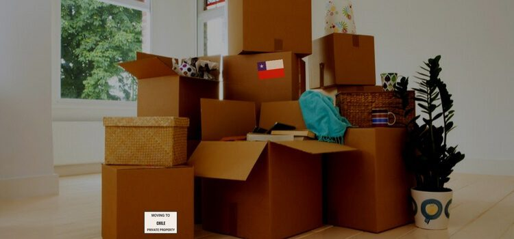 A group of boxes sitting in a living room getting ready for a move to Chile.