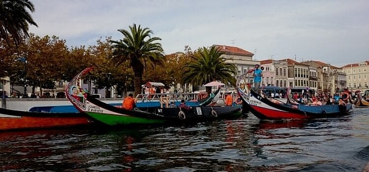 Traveling along Portugal's waters with a brightly colored boat
