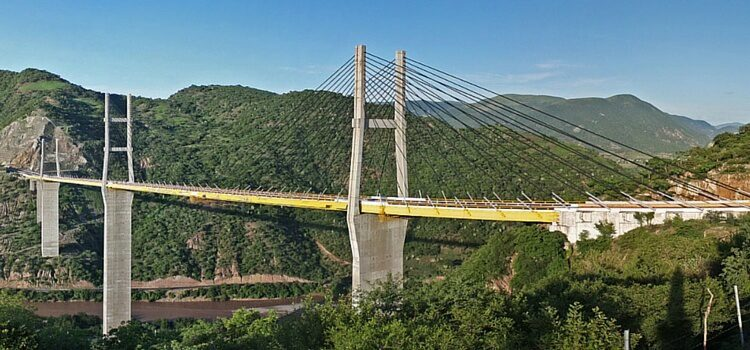 A bridge and green mountains in Mexico