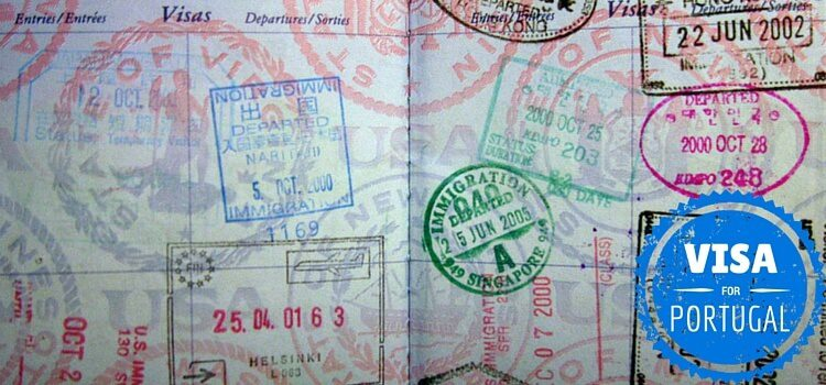 A passport full of stamps including a Portugal visa stamp