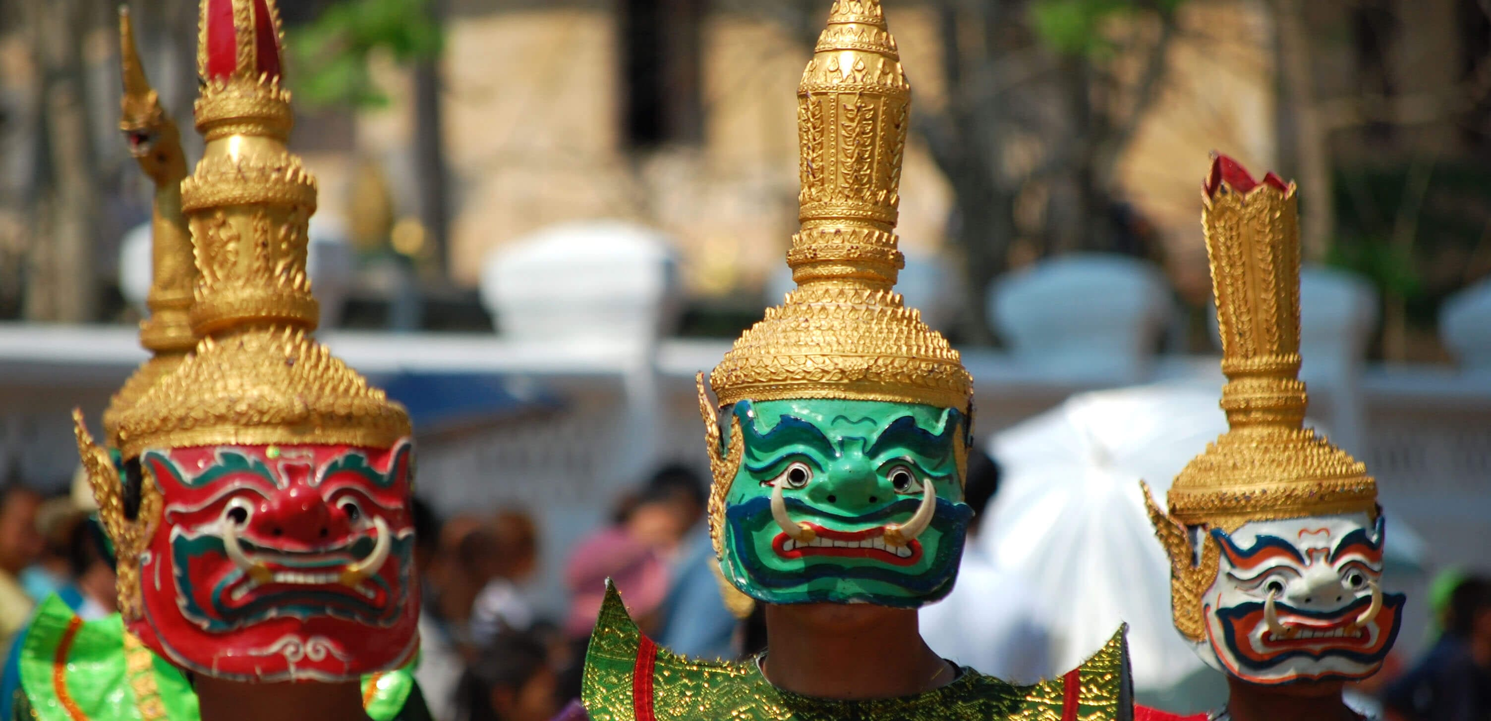 people wearing colorful New years Masks in Laos