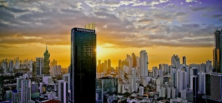 A view of Panama's financial district with Tower Bank in the forefront and the sunset in the back
