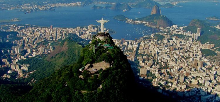 An aerial view of Rio de Janeiro, Brazil with christ the redeamer overlooking the city