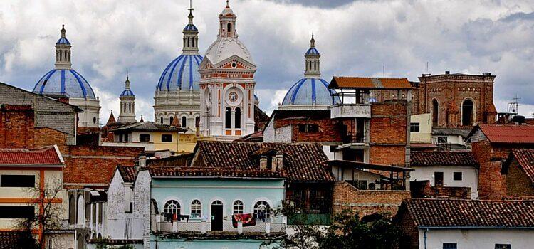 The beautiful brick buildings, softly painted buildings, and jutting church steeples of Cuenca, Ecuador