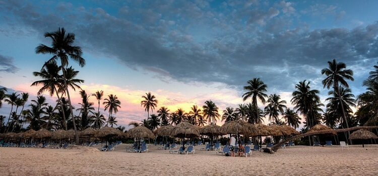 The amazing weather in the Dominican Republic, complete with blue skies, white sand, and a heavenly sunset.