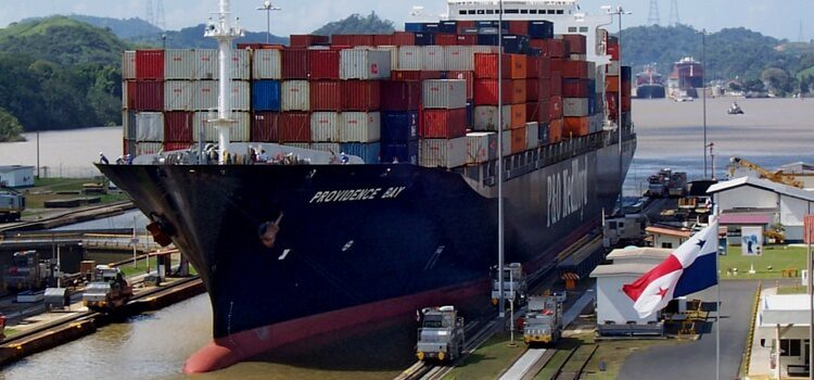Large container ship going through the Panama Canal with lots of cargo containers